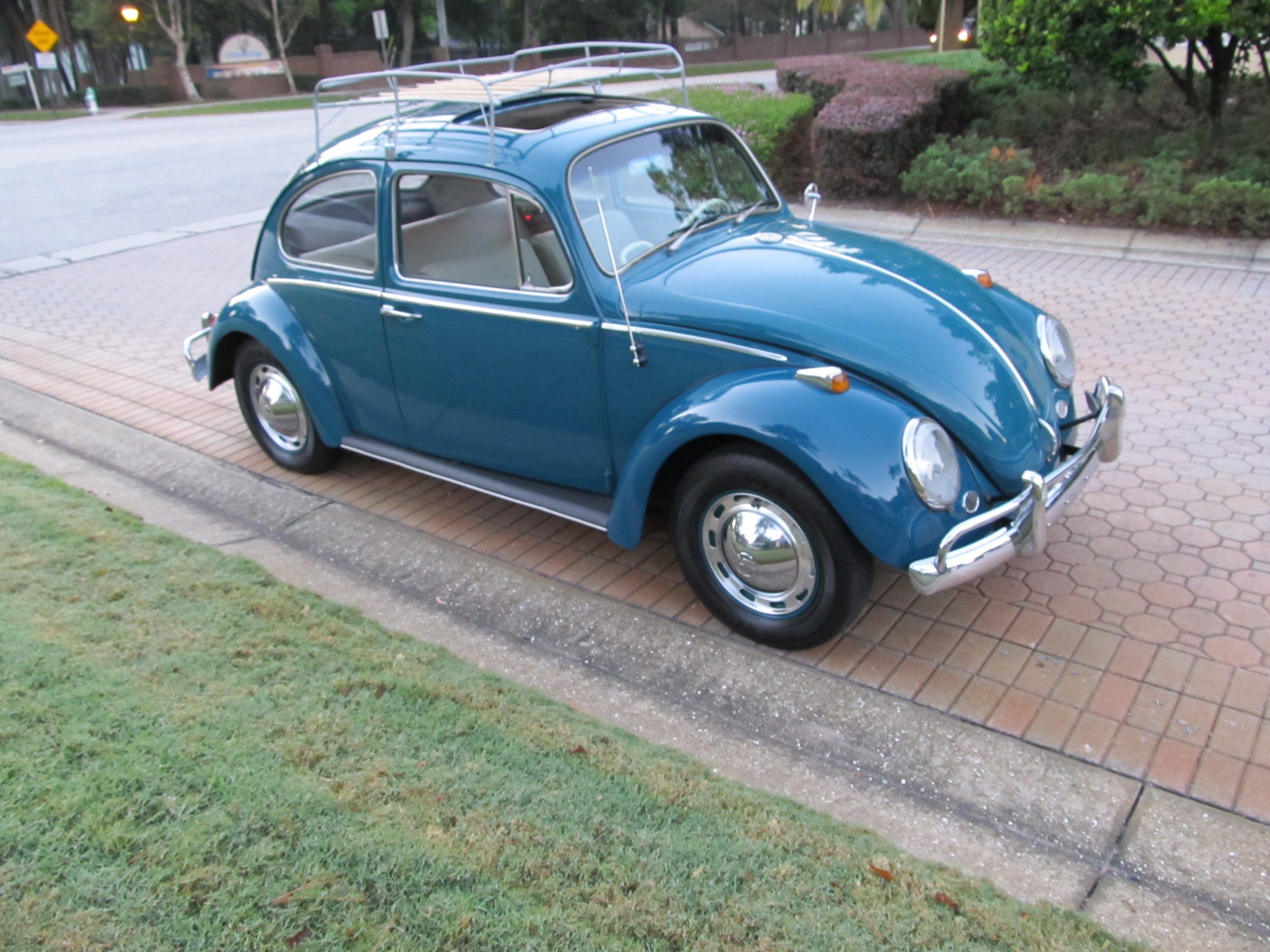 1965 volkswagen beetle a nicely restored sunroof bug finished in sea blue with the new bone interior including headliner and carpet it has 68